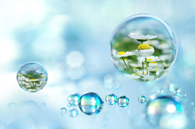Every raindrop has a spring within. Don't give up hope concept; spring within a raindrop stock photography