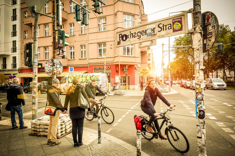 Everyday life on Berlin streets. BERLIN, GERMANY - OCTOBER 7, 2016: motion view of everyday life with bikers and pedestrians at beginning of Box Hagener Strasse royalty free stock photo