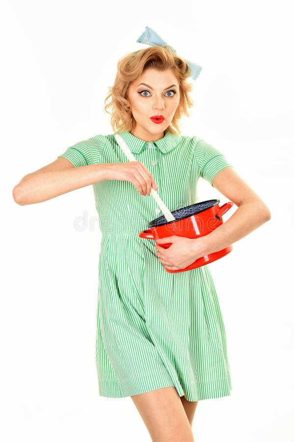 Everyday life, housework. Everyday lifeof housewife with pot cooking isolated on white stock images