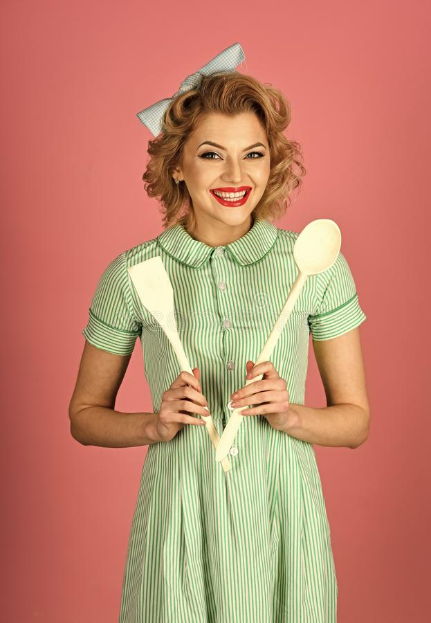 Everyday life, housework. Pinup woman cook hold kitchenware, retro style, maid. Housekeeper with kitchen utensil, household. Retro woman cooking, gender stock images