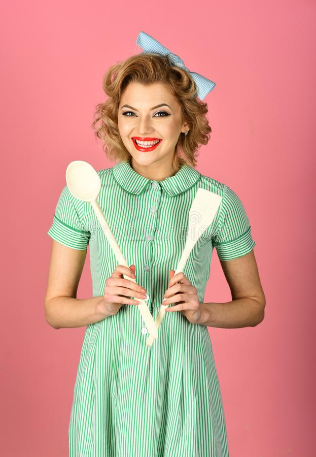 Everyday life, housework. Pinup woman cook hold kitchenware, retro style, maid. Housekeeper with kitchen utensil, household. Retro woman cooking, gender royalty free stock image