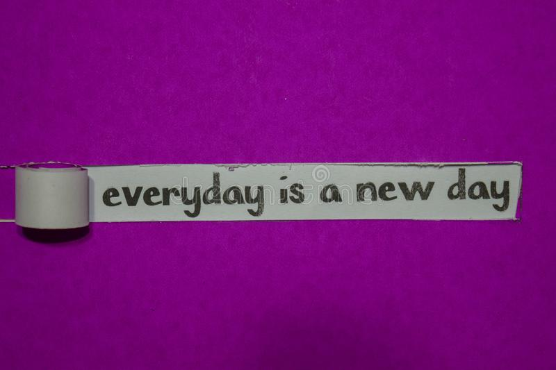 Everyday is A New Day, Inspiration, Motivation and business concept on purple torn paper stock image