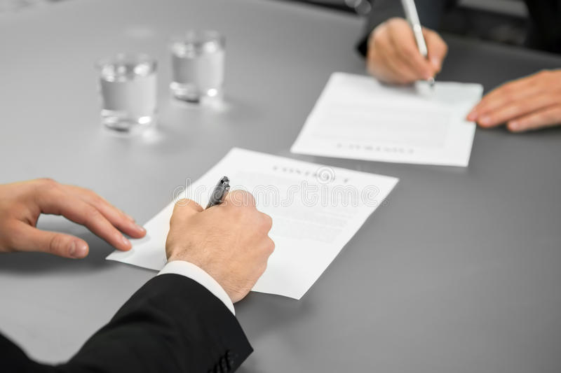Everything is official. Two businessman make a deal. A corporate agreement. Giving guarantees. Everything is official stock photography