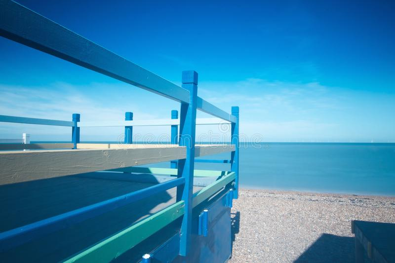 Beach Hut Blues. Everything about this photo says summer. Blue skies, blue sea and crisp lines stock photo