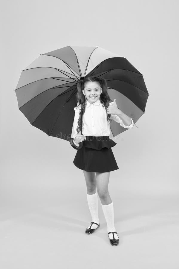Everything under control. Fancy schoolgirl. Girl with umbrella. Rainy day. Happy childhood. Rainbow umbrella. Kid happy. With umbrella. Fall weather forecast royalty free stock photos