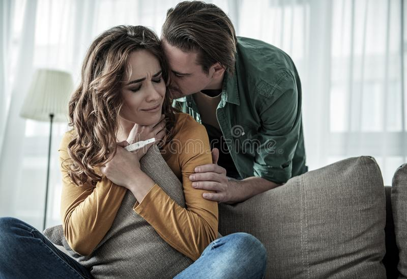 Shocked loving couple finding out about female pregnancy royalty free stock photo