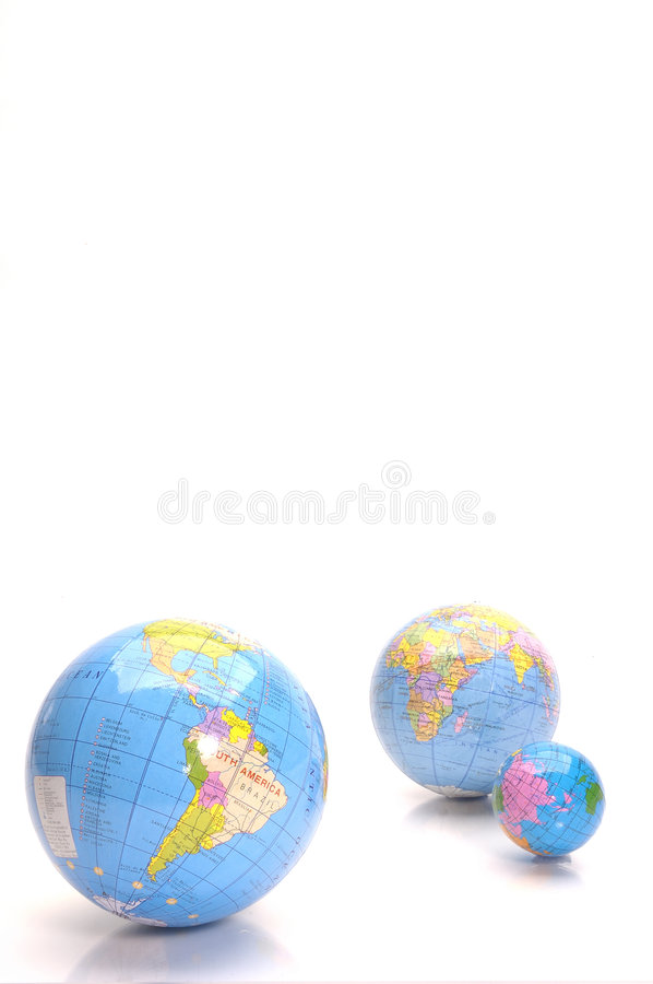 Almost Everywhere. In the world.Three globes from large to small stock images