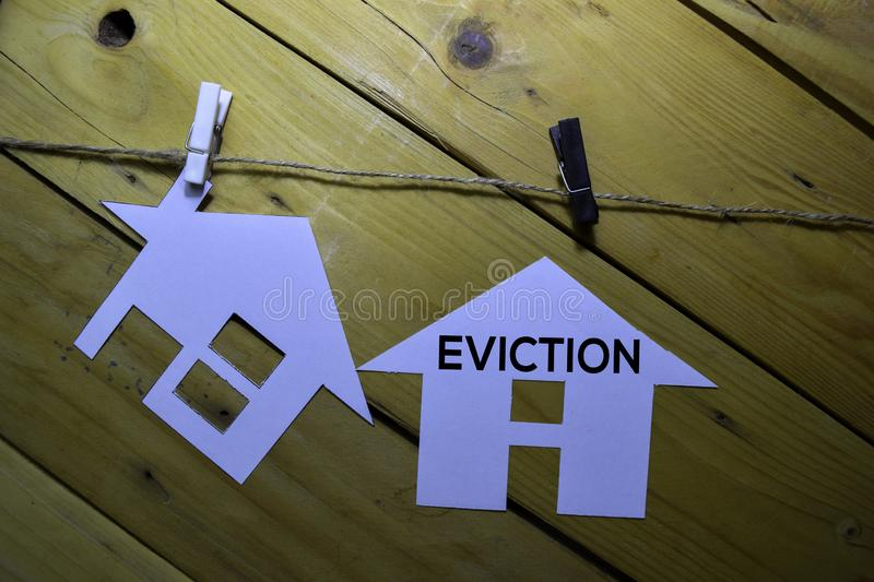 Eviction text on house made by paper isolated on the tables royalty free stock image