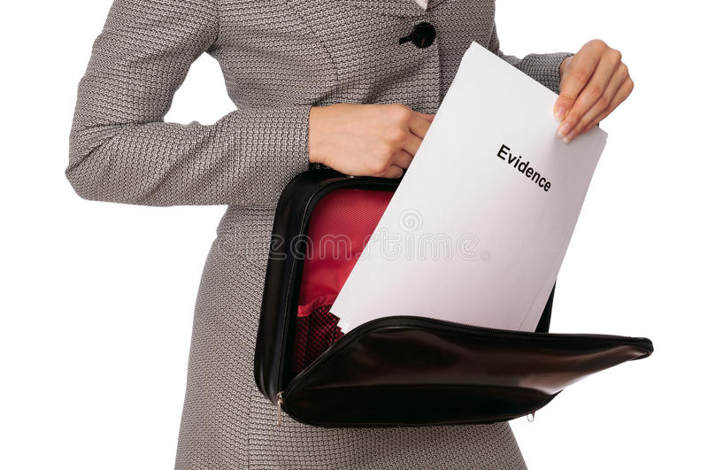 Evidence. Investigator examines in details the materials of evidence reported by advocate stock photo