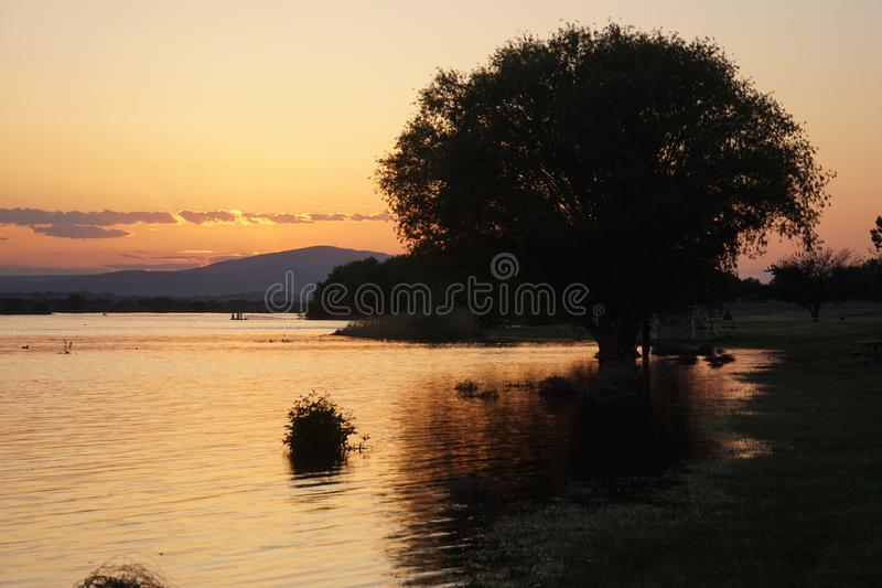 Evidence of Global Warming: Rattlesnake Mountain Sunset during Spring Flooding, Richland, WA. Global Warming evidence coming to a river near you. May Flooding royalty free stock photography
