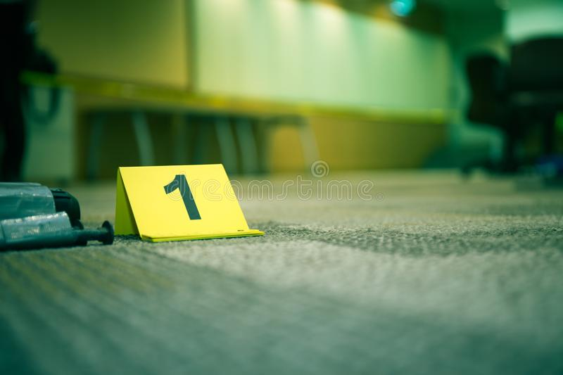 Evidence marker number 7 on carpet floor near suspect object in royalty free stock photo