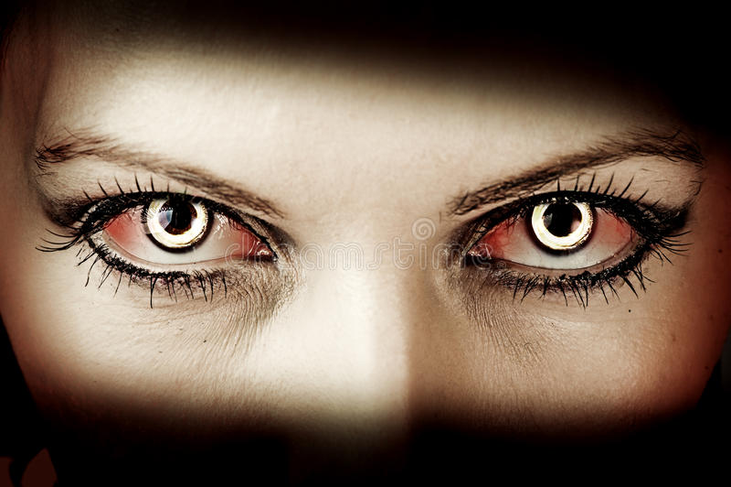 Evil zombie eyes. Evil bloody female zombie eyes. dirt make up. Macro. Halloween theme stock image