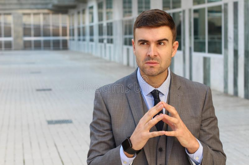 Evil businessman planning a revenge royalty free stock photography