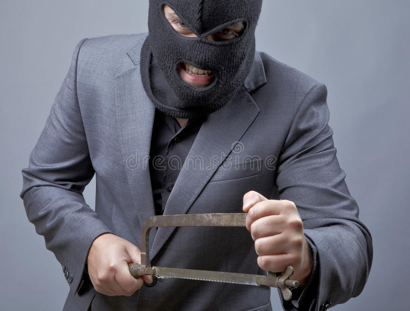 Evil criminal wearing military mask stock images