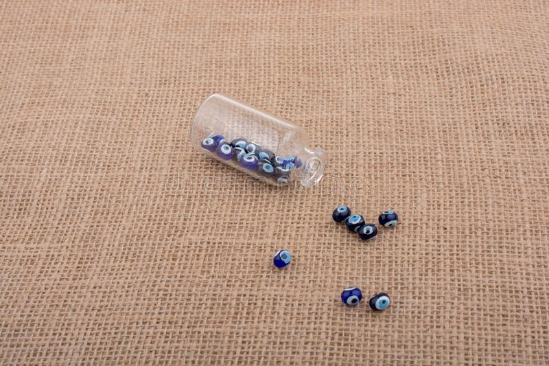 Evil eye bead in bottle as  souvenir. From Turkey royalty free stock image