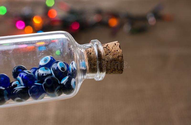 Evil eye bead in bottle as  souvenir. From Turkey stock image