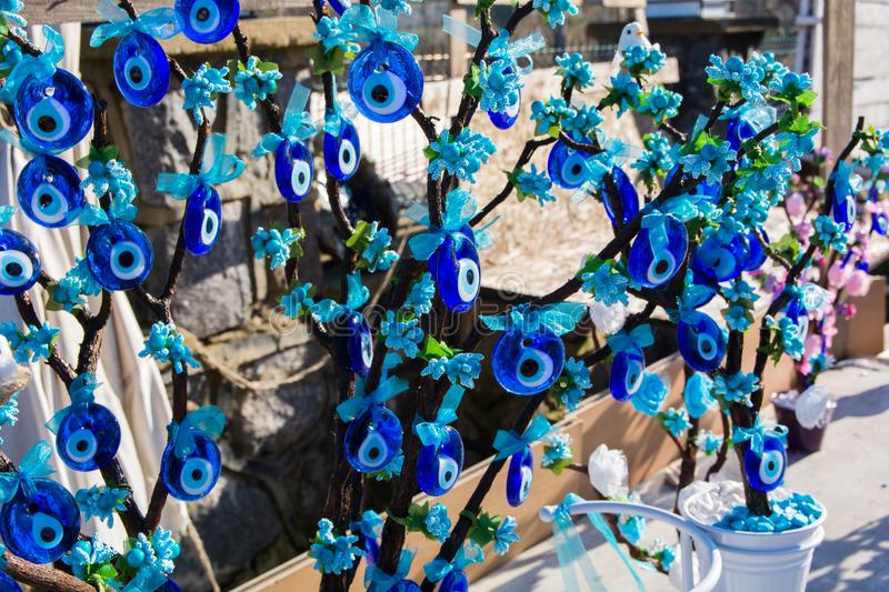 Evil Eye Bead. Wish Tree. Evil eye bead souvenirs.broken glass is melted and shaped. In culture and religious belief, the figure of the eye is regarded as a royalty free stock image