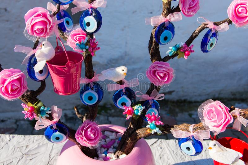 Evil Eye Bead. Wish Tree. Evil eye bead souvenirs.broken glass is melted and shaped. In culture and religious belief, the figure of the eye is regarded as a stock images