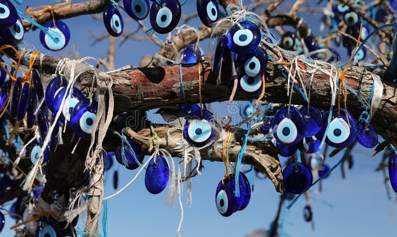 Evil Eye Beads Tree in Pigeons Valley, Cappadocia, Nevsehir, Turkey. Evil Eye Beads Tree in Pigeons Valley, Cappadocia, Nevsehir City, Turkey royalty free stock photos