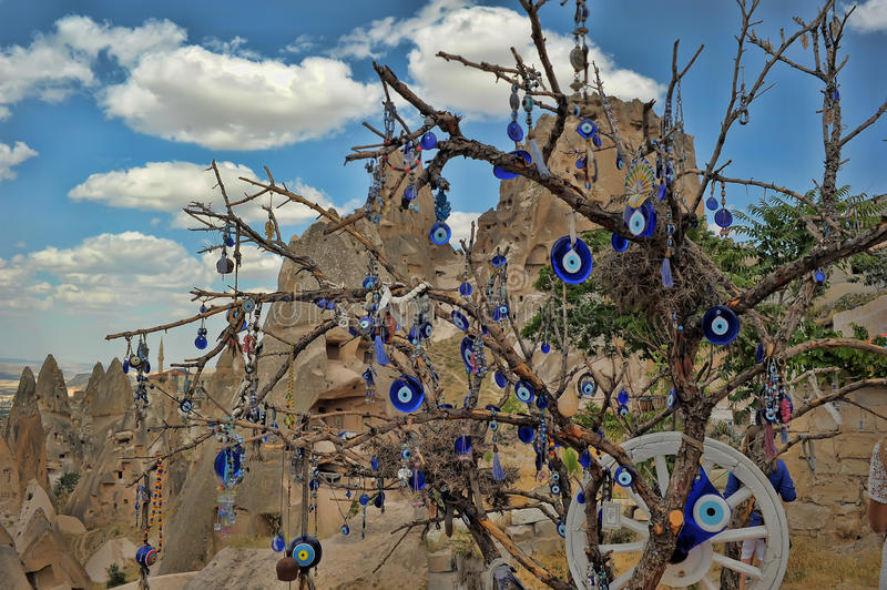 Evil eye charms hang from a bare tree in Cappadoci. A, Turkey stock photo