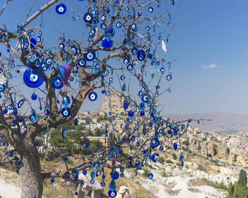 Evil eye. Charms hang from a bare tree in Cappadocia, Turkey stock photos