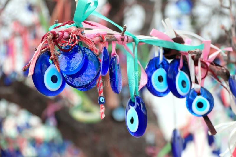 Evil eye charms hang from a tree in Cappadocia, Anatolia, Turkey. Many glass mascots - evil eye charms hang from a tree in Cappadocia, Pigeon valley, Anatolia stock image