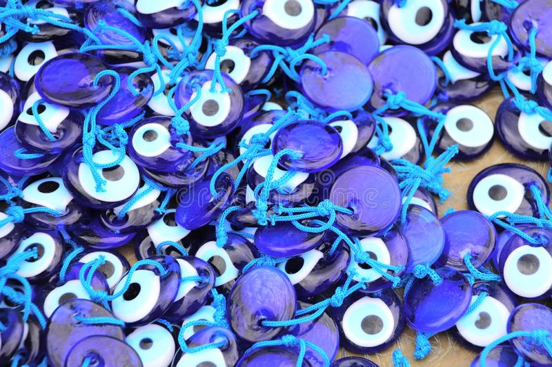 Evil eye charms, traditional turkish souvenirs, Turkey. Many glass mascots - evil eye charms, traditional turkish souvenirs, Turkey royalty free stock photography