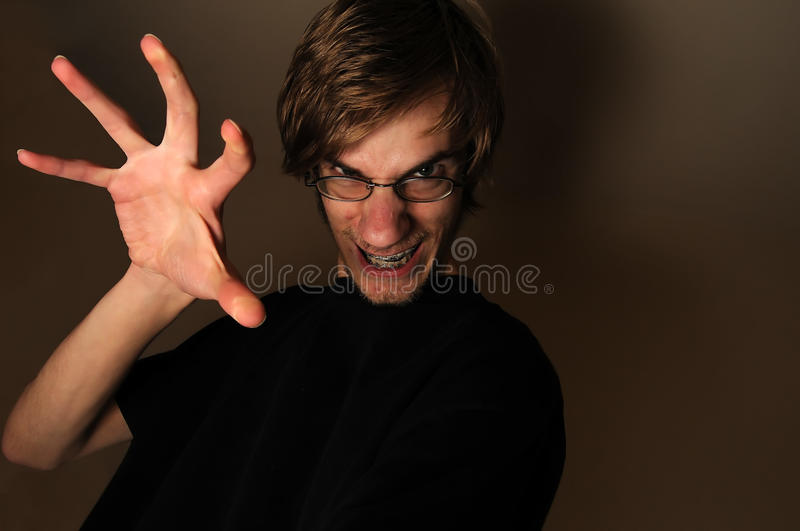 Evil Grin With Hand Royalty Free Stock Photos