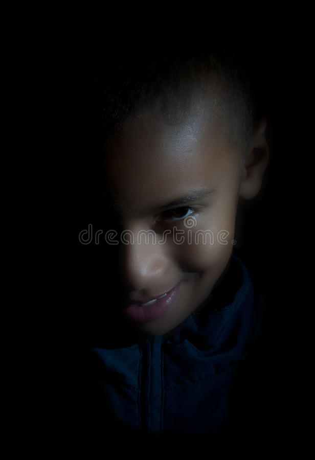 Evil look young boy royalty free stock photo