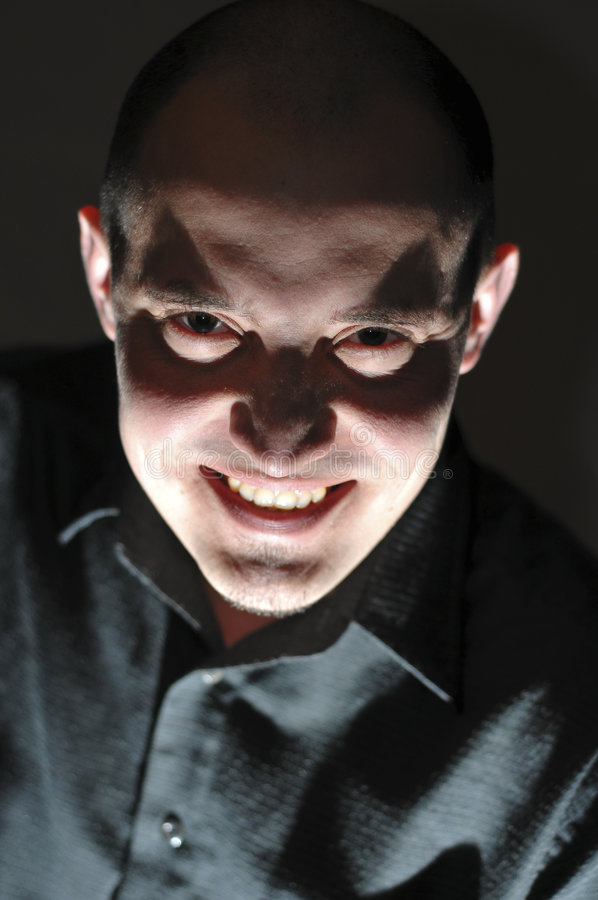 Evil man. With dark smile and look stock photo