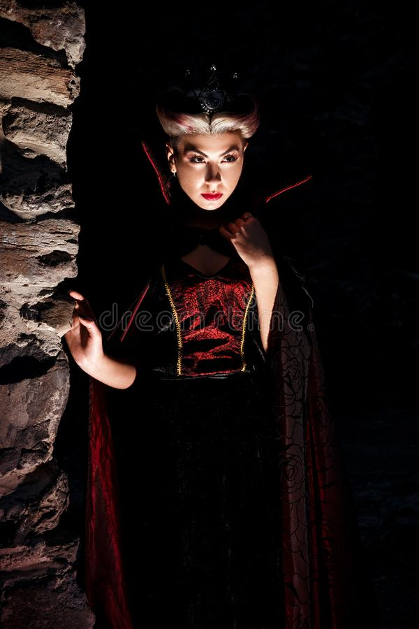 Evil queen with a crown in a fantastic portrait - Beautiful myst stock photos