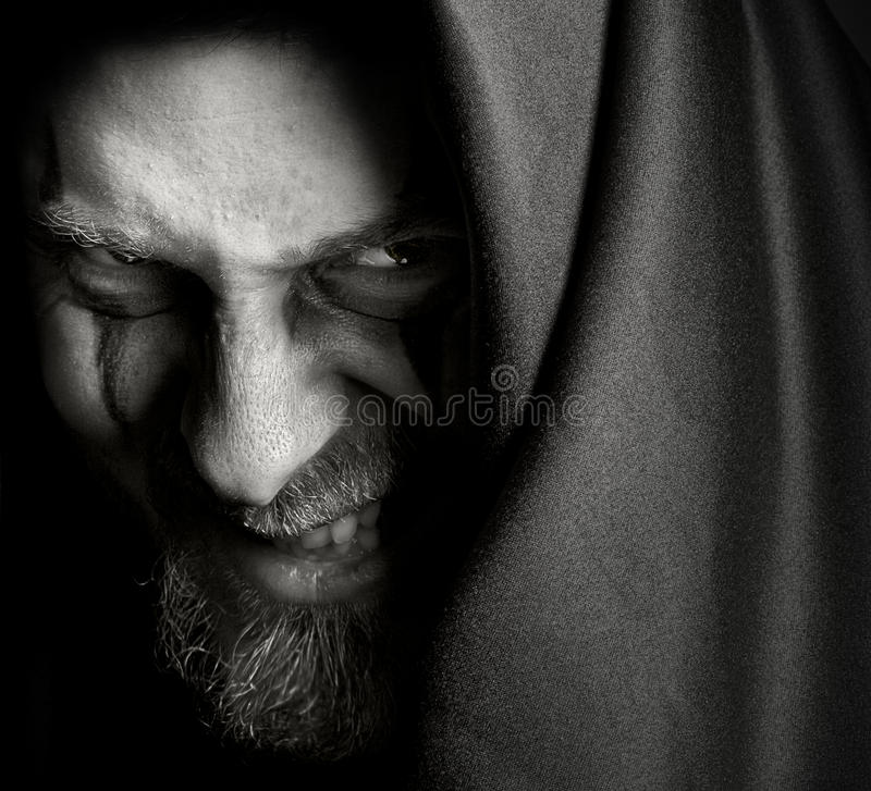 Free Evil Sinister Man With Malefic Wicked Grin Royalty Free Stock Photo - 11030655