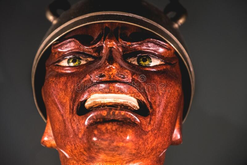 Evil soldier face statue at the Masone Labyrinth Art Museum of Fontanellato in province of Parma , Italy stock images
