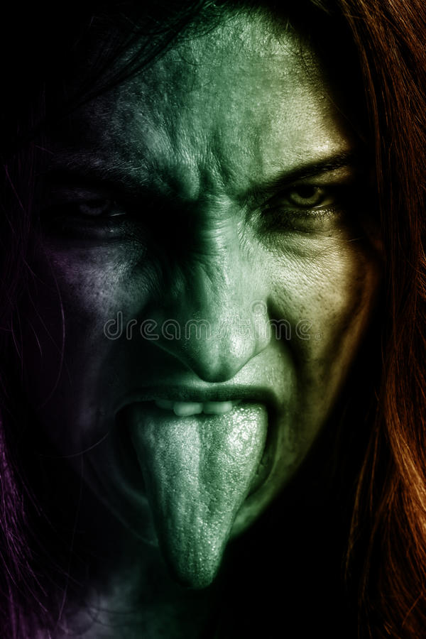Evil woman with scary horror face stock photo
