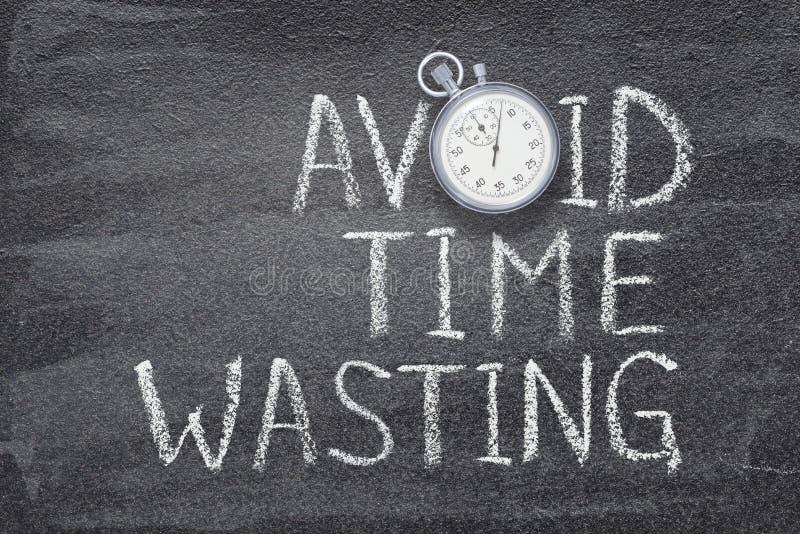 Eviti il tempo che spreca l'orologio fotografia stock libera da diritti