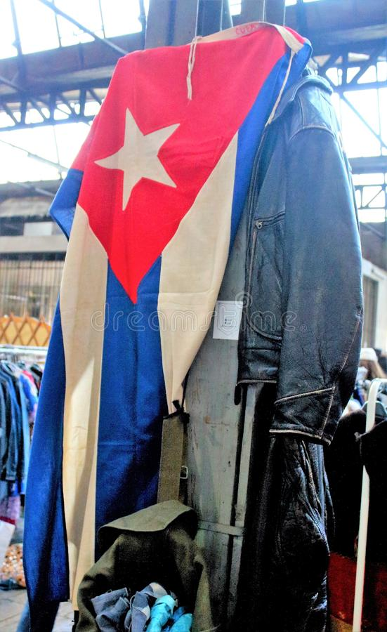 Man aviator leather jacket with Cuba flag at a vintage market royalty free stock image