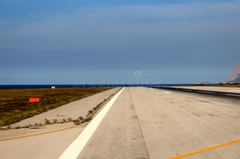 Airport runway from the plane. Evocative imagine of airport runway from the plane stock image