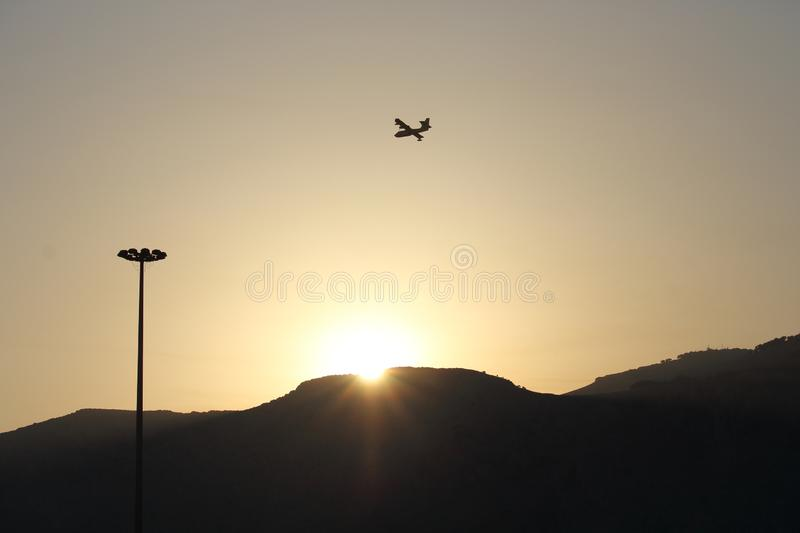 Canadair in action at dawn. Evocative imagine of canadair in action at dawn royalty free stock image