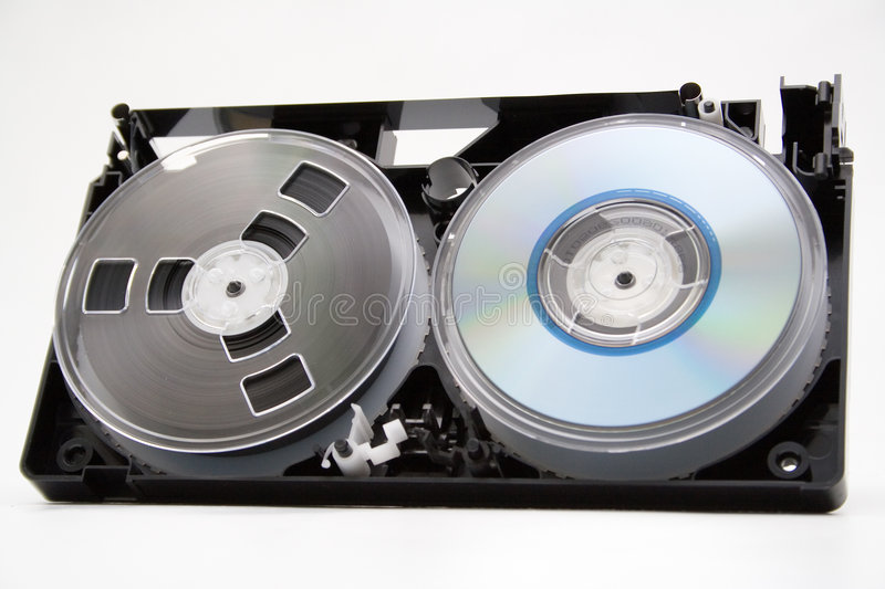 Evolution. Take to pieces VHS cassette and CD disc on white background royalty free stock photos