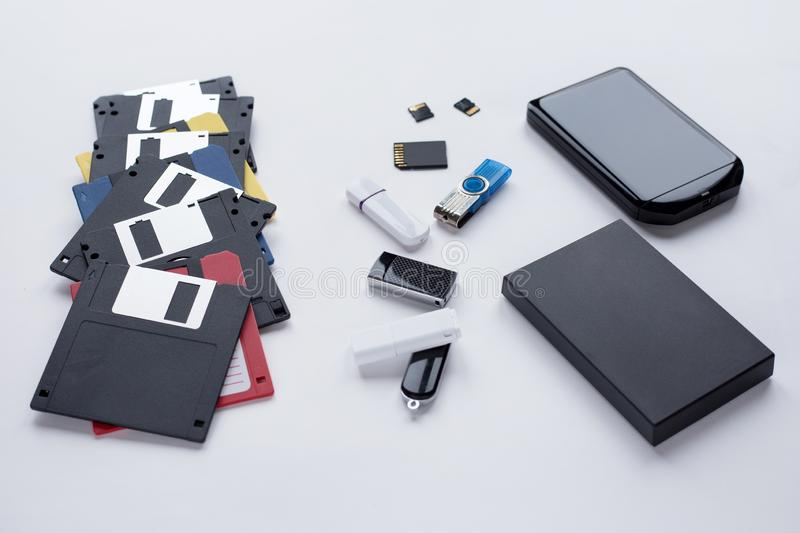 The evolution of digital devices for the transfer and storage of information. Objects isolated on white background. Modern and retro technology stock photos