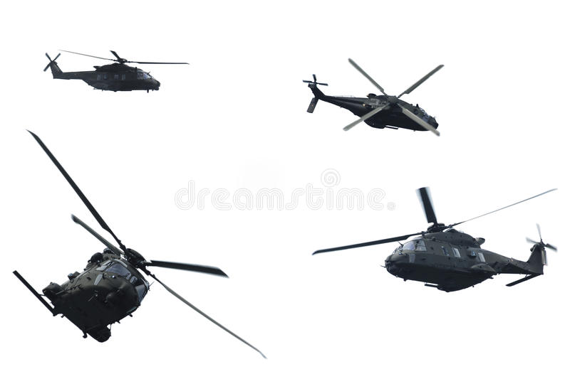 Evolution of flight of a military helicopter stock photos