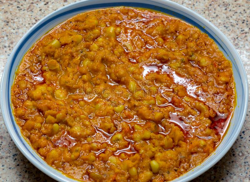 Ewa brown honey beans in palm oil. Ewa is a delicious staple food in most West African Countries particularly Nigeria. This one is made from brown honey beans stock images