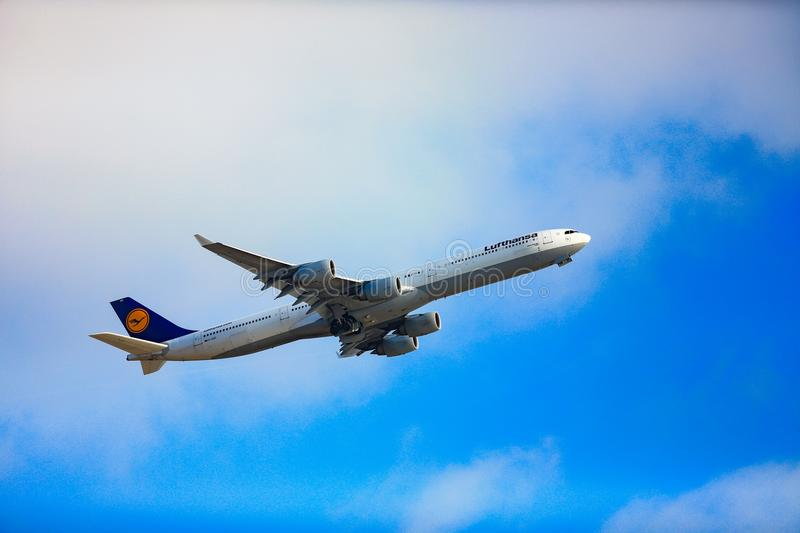 Lufthansa`s Airbus 340 taking off from LAX royalty free stock photo