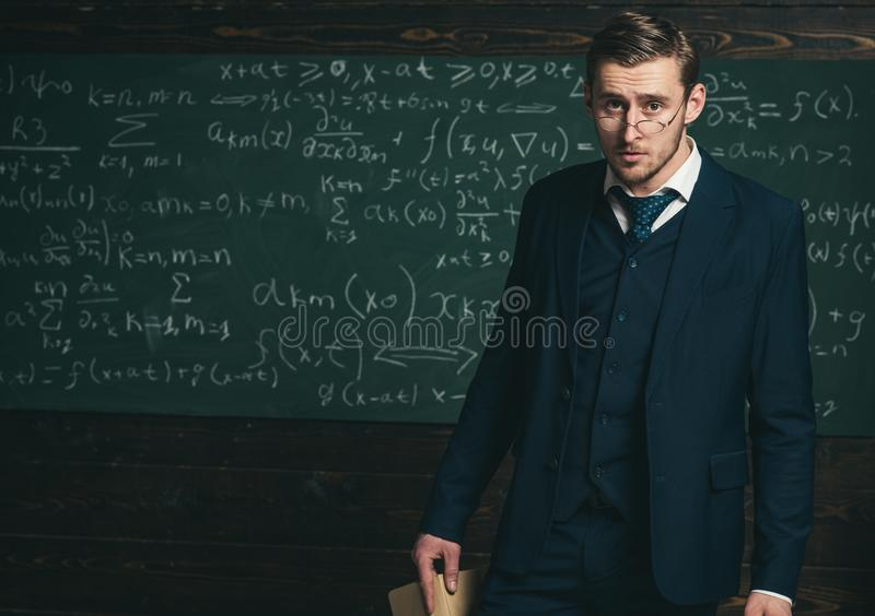 Exacting teacher. Man with high expectations looks unsatisfied with students knowledge. Professor exacting and strict stock photos