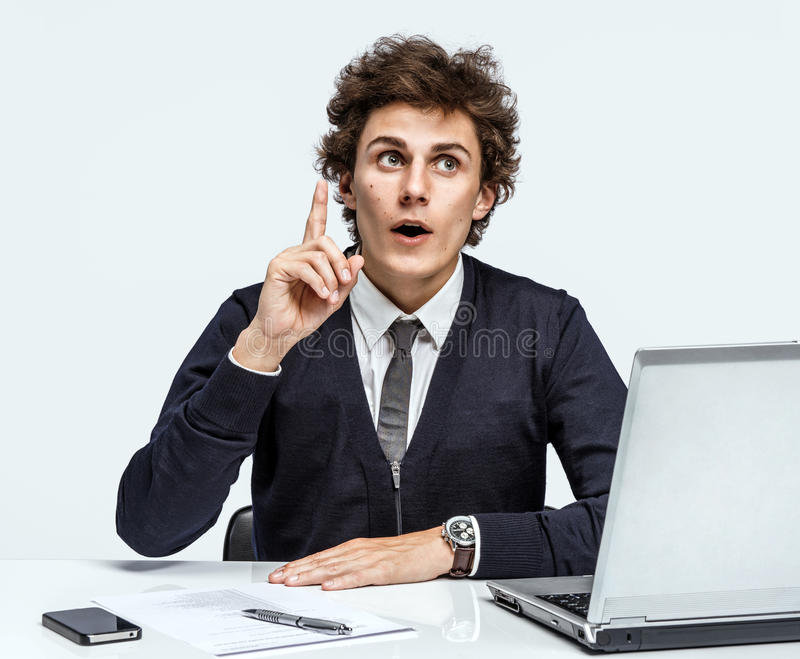 Exactly! Cool idea, finally remembered. Businessman at the workplace working with computer on gray background royalty free stock images