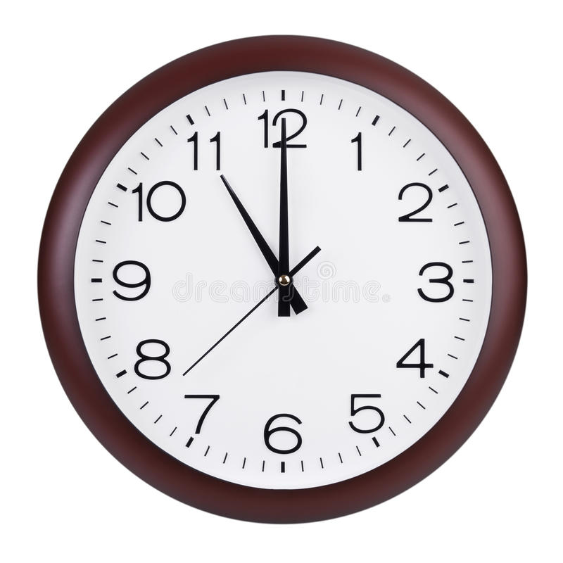 Exactly eleven hours on a round dial. Exactly eleven hours on a big round dial royalty free stock photos
