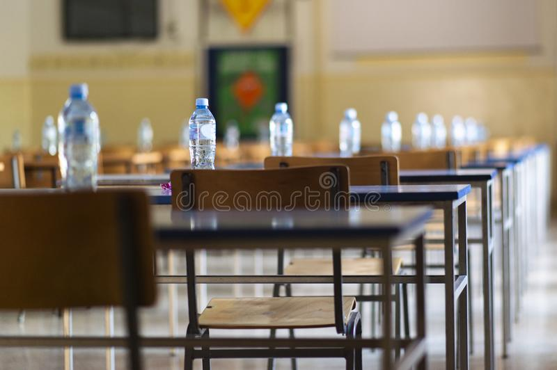 Exam examination room or hall set up ready for students to sit test. multiple desks tables and chairs. Education, school, student. Life concept royalty free stock photos