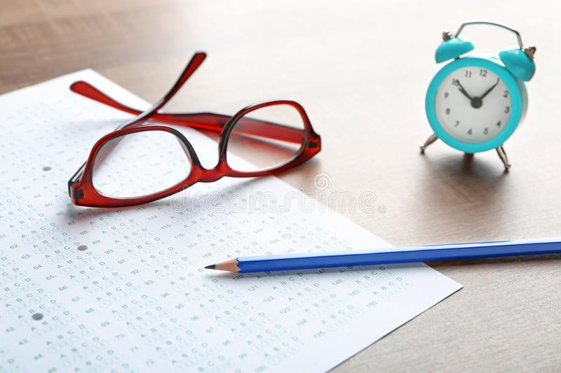 Exam form, pencil and student`s eyeglasses stock photos