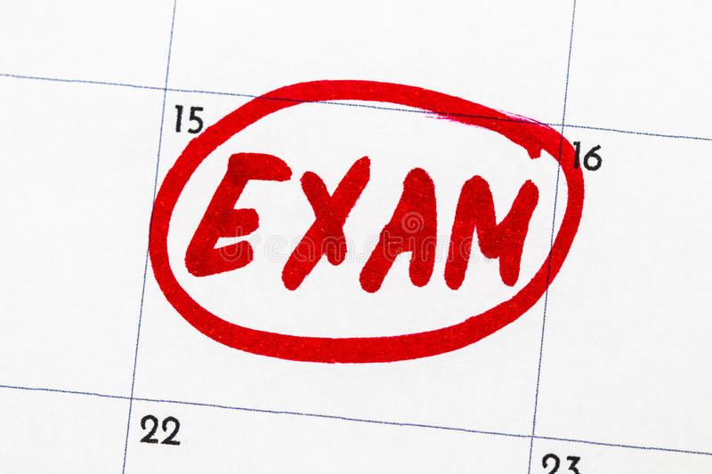 `exam` is the text written on the calendar in red marker royalty free stock photo