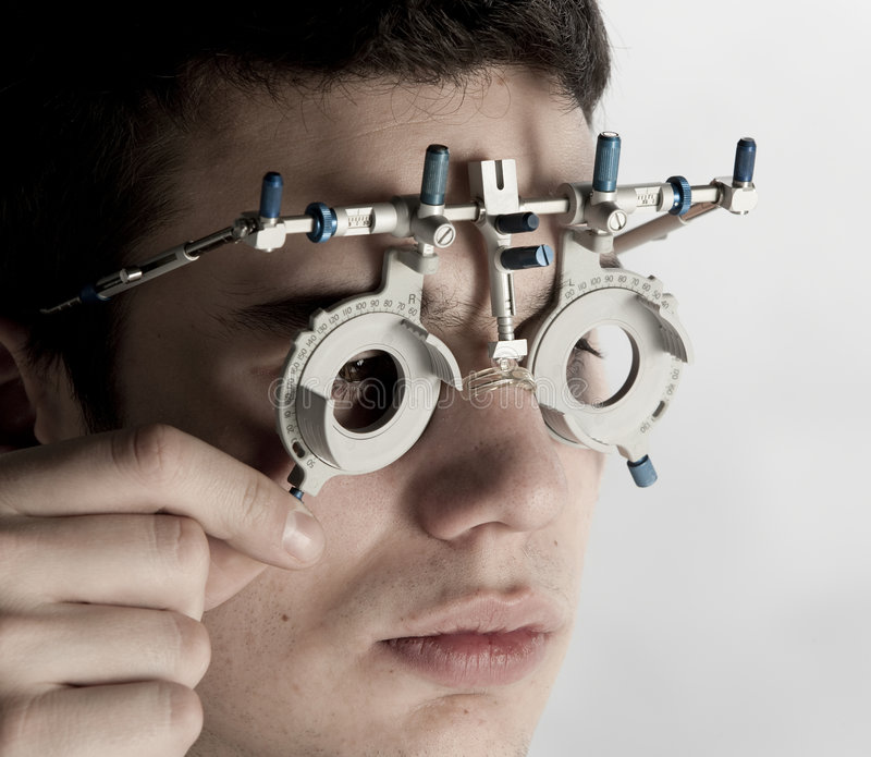 Exame do Optometrist imagens de stock royalty free
